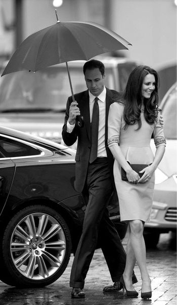 Love this of Will and Kate.. he holds the umbrella for her!