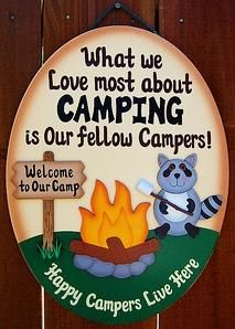 """10 1/2"""" x 14"""" Camping sign is made from wood and hand painted witha cream colorexterior paint. Letters are painted brown. Racoon, fire, andthe Welcometo our camp,sign are allseparate piece of wood,whichareattached to the camping sign. It is finished with a light brown shaded edge around the outside, which creates a unique finish. Our camping signs are painted with a very high quality exterior paint, therefor they can be displayed indoors as well as outdoors. Names can be ..."""