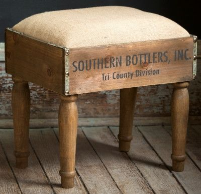 """Do you need a cute foot stool or side table? This vintage-inspired foot stool is made from a bottle crate and topped with a burlap covered cushion. 15 ¾"""" Wide x 12"""" Deep x 15 ½"""" High Certain photograp"""