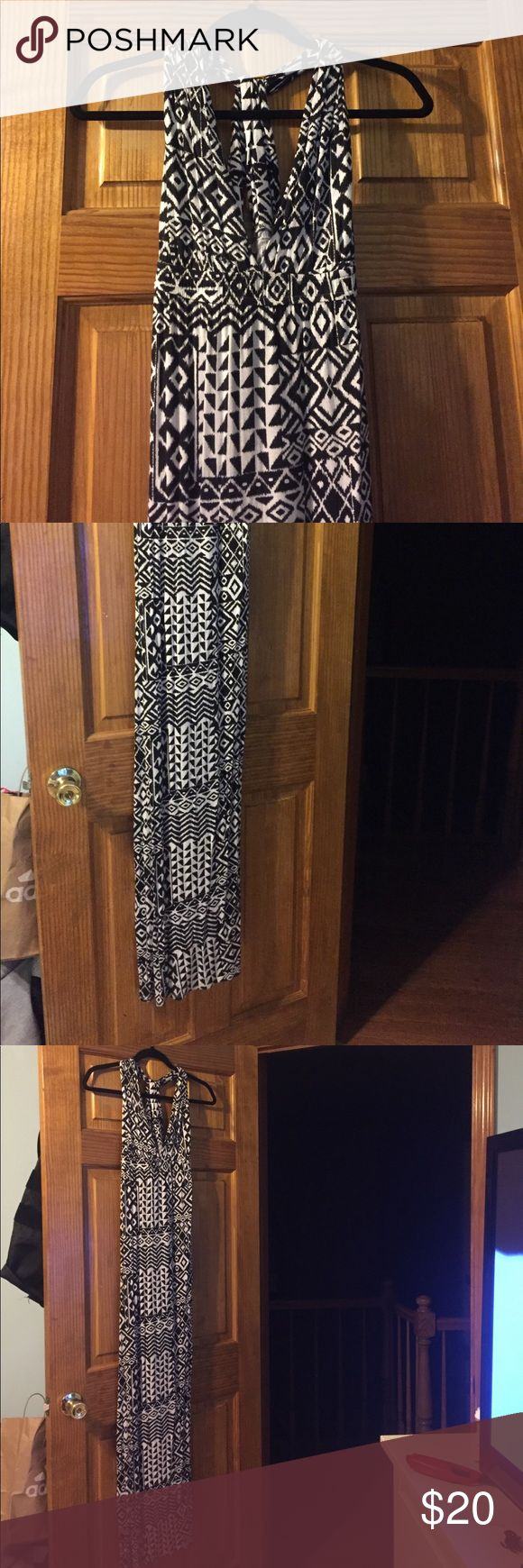 "Tribal Maxi Dress tribal print black and white maxi dress! perfect for any occasion. Back has criss cross detail. No flaws, worn twice. I'm 5'4"" and this falls right above heel. Would be great fit for all! Dresses Maxi"