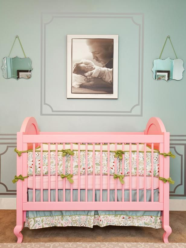 I swore I wouldn't like all the girly girl stuff with T, but I find I can't help it! I love this pink crib...