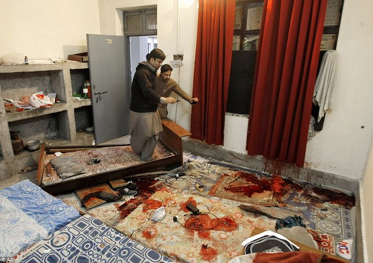 Scene of horror: Pakistani students look at a blood-soaked room inside a hostel after the attack at Bacha Khan University in Charsadda