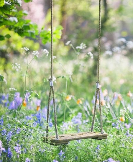 English Country Cottage Garden Swing amongst the Flowers