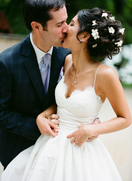 her dress... Love it, tired of the strapless.  Every time i see a bride wear one, all she does is pull it all day/night!