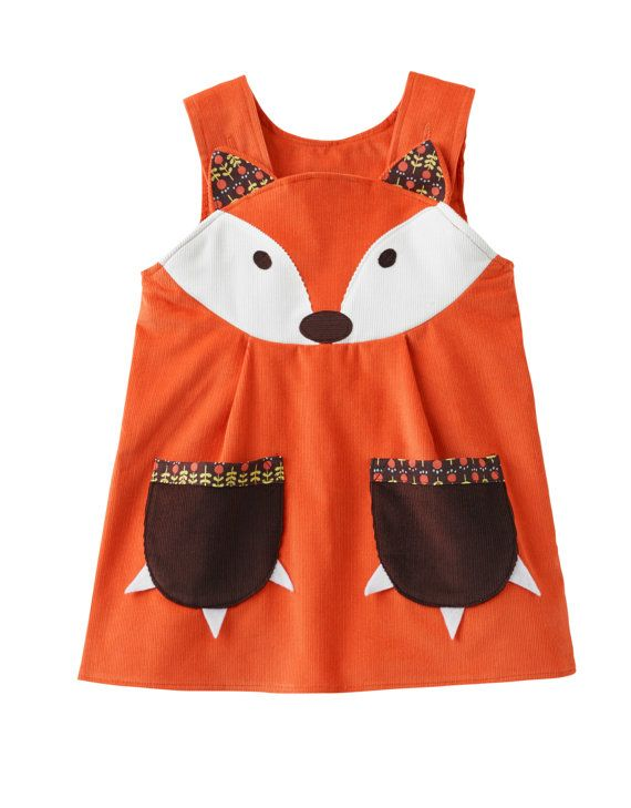 Fox character handmade dress for baby ,toddlers and little girls in beautiful soft rust corduroy  Due to popular demand for Little Miss Mouse,Mr Fox in socks has arrived on the scene,and hunting for adventure.  Classic pinafore shape in burnt orange European superior quality super soft 100% cotton needle corduroy. Button strap fastenings on inside of yoke. Chocolate spot print on inside with Wild Things labelling. Beautiful fox applique on the front yoke, with little ears,and matching…