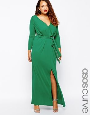 We love the emerald hue of this long green plus size dress and the perfect detailing. The v-neck line and the slit shows off just enough skin, while the belt around the waist emphasizes your curves: ASOS CURVE Maxi Dress With Tie Front