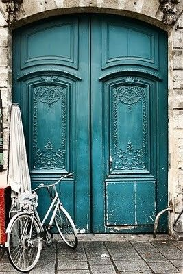 Blue door and bycycle