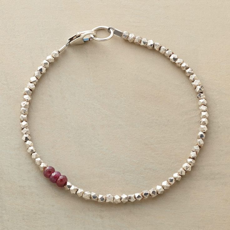"""DIVERSIONS BRACELET--In a colorful diversion, three rubies interrupt sterling silver beads. Exclusive. Handmade in USA. Lobster clasp. 7-1/4""""L."""