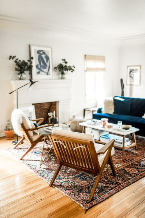 blue couch fur oriental rug and wooden furniture