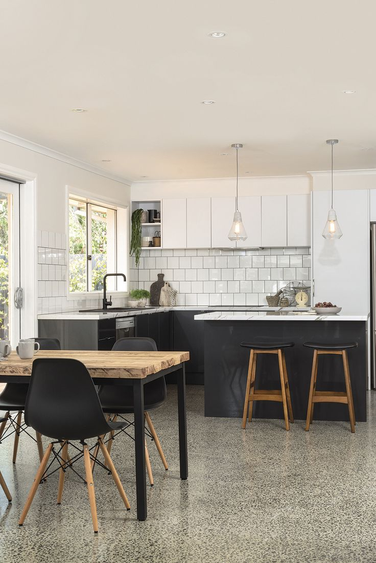 Another ageless colour scheme featured in this kitchen design. Delightful nougat truffle wall doors and panels, lumpiness metallic base doors and panels combined with the calcutta benchtop from kaboodle kitchens.