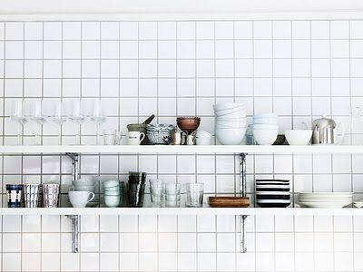 love dishes stacked on shelves in the kitchen