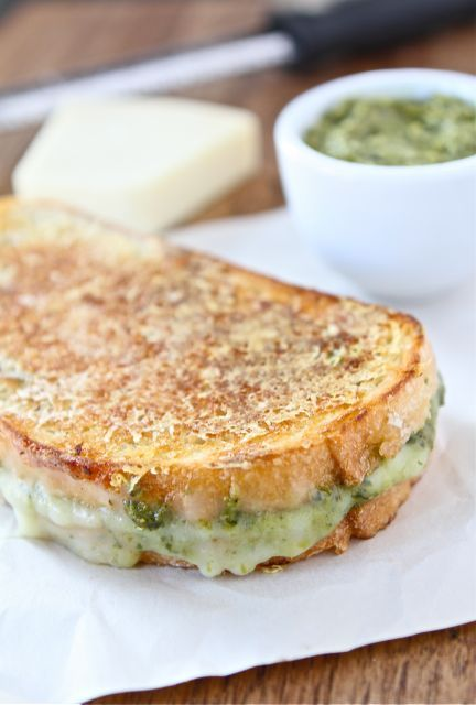 Parmesan Crusted Pesto Grilled Cheese: 2 slices ciabatta or French bread 1 tablespoon soft butter, for brushing the bread 2 slices mozzarella cheese 2 tablespoons basil pesto 1/3 cup finely shredded Parmesan cheese