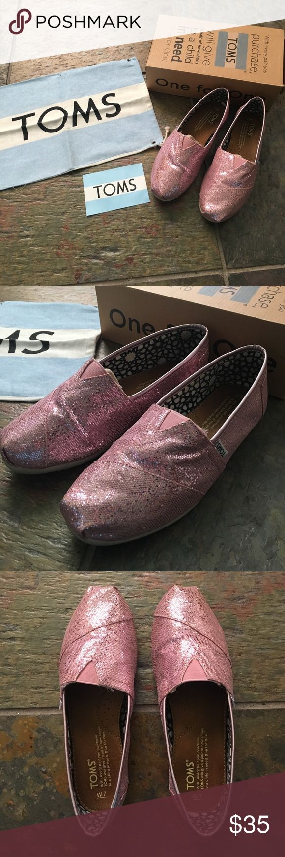 TOMS classics slip-on pink glitter shoe Women's size 7. Gently worn. Great condition. Comes with the box, TOMS bag, and sticker. TOMS Shoes Flats & Loafers
