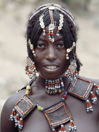 Africa | Young Afar Girl at Senbete Market, Her elaborately decorated hairstyle and beaded jewellery are typical of unmarried girls in her tribe. Facial markings are not unusual. Ethiopia | © Nigel Pavitt