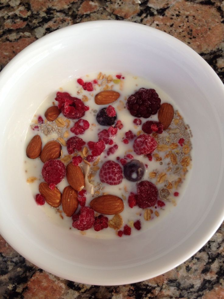 Museli, almonds, chia seeds and mixed frozen berries with milk