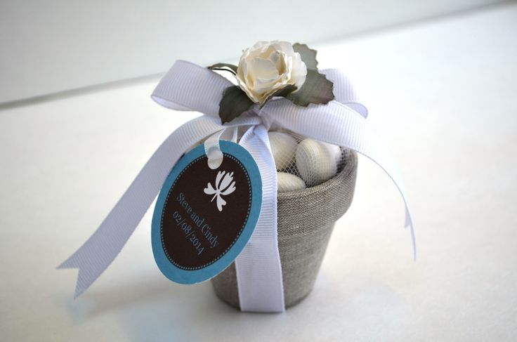 Wedding Favor lined with linen and filled with sugar coated almonds.