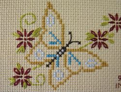 A butterfly motif I cross-stitched from the Stamped Goods sampler, found in Better Homes & Gardens Beautiful Cross Stitch book.