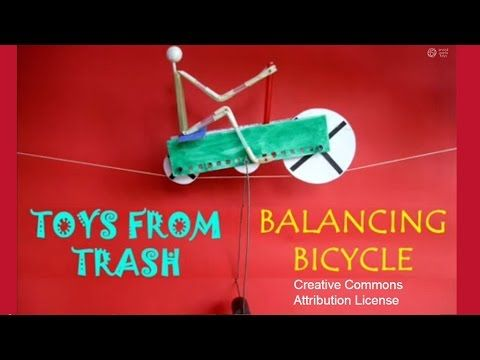 This balancing bicycle is like an acrobat balancing on a tight rope. The heavy weights hanging from the wire loop lowers its center of gravity. The bicycle w...