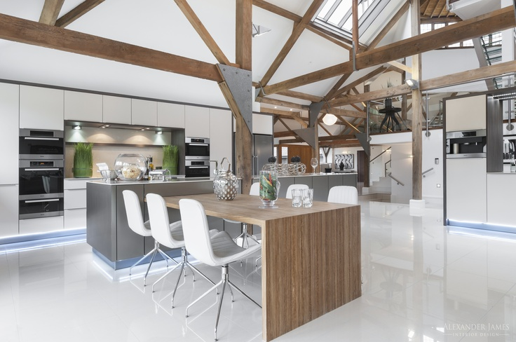 The contemporary interior hidden inside this traditional barn creates a dynamic atmosphere and a unique home. #interiors #design #kitchen