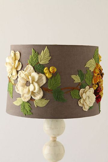 An embroidered lamp shade like this one from Anthropologie is a dynamic addition to any room
