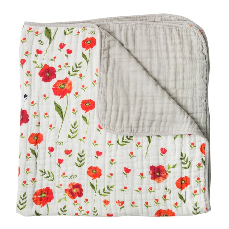 Love this. Mostly because it's a girly departure from the traditional pink. The red poppy muslin toddler quilt.