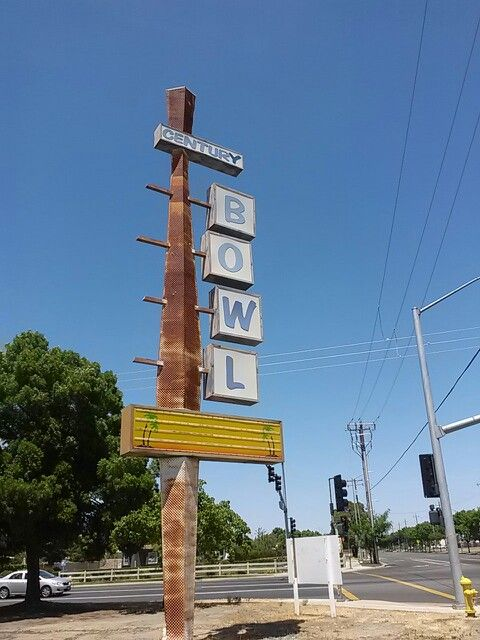 Old bowling alley sign in Merced California on child and Parsons
