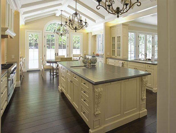 Modern french country kitchen with table drawer of lid using gray countertop complete sink classic steel faucet and chandelier design also beige scheme wall color that have dark wooden flooring inspiration ideas