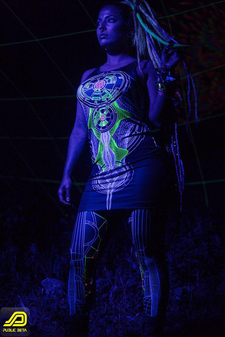 Neuron Dress with Colony Leggings - by Public Beta Wear www.publicbetawear.com Futuristic style visionary designs on clothing. Glow in the blacklight.  Photo by Murilo Ganesh @muriloganesh, Model: Mariana Jeveaux @tookthattrip #publicbetawear #blacklightclothing #ozorafestival #partywear #psychedelic #shopbitcoin #boomfestival #burningman