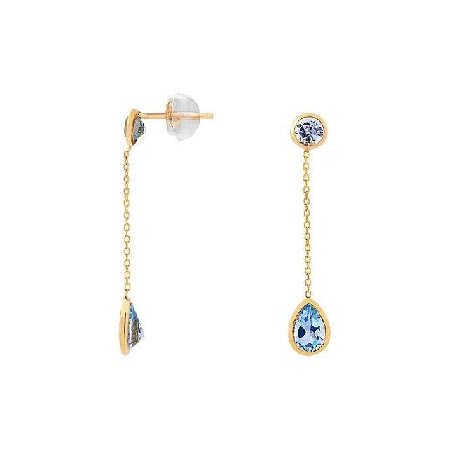 Boucles d'oreilles CLEOR en Or 375/1000 jaune avec Topaze bleue.  - Couleur de pierre : Bleu - Couleur du métal : Doré - Marque : CLEOR - Matière : Or 375/1000 - Pierre : Topaze - Style : Classique - Type de bijou : Boucles d'oreilles - Type de boucle oreille : Boucles d'oreilles - Univers : Femme