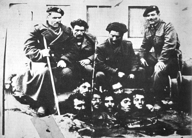 Anti-communist militamen display their victims in the Greek Civil War.