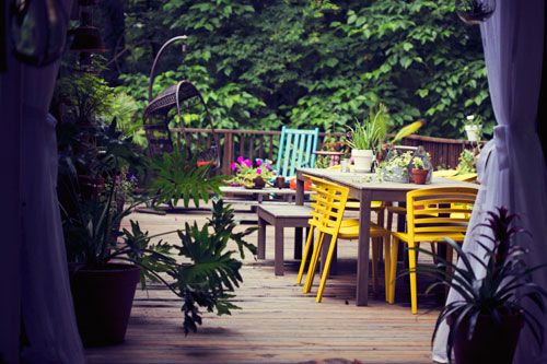 Outdoor escape: dining area....love the bright chairs
