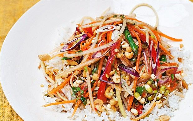 A deliciously tangy salad of papaya, carrot, spring onion, tomato and sprouted beans served with creamy coconut rice