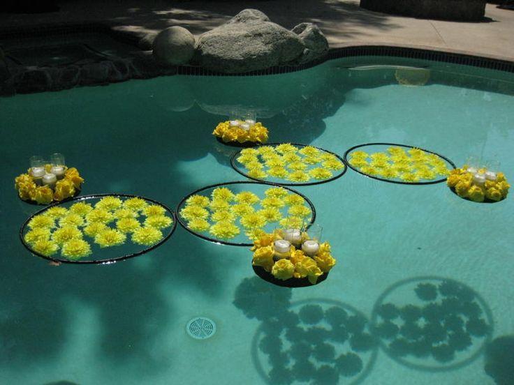 Floating flower arrangements are always a popular pool decoration.  Loving this hoop idea! via Mille Fiori