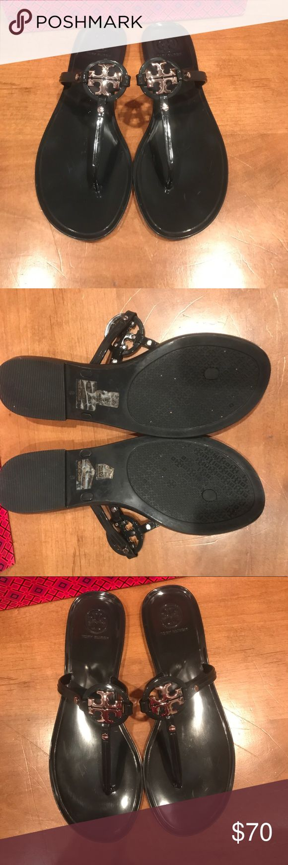 Tory Burch Mini Miller Flat Sandal These shoes are Navy Blue and we're purchased at Tory Burch however I don't have the original box but could send Tory Burch gift packaging if buyer would like. I  have only worn these 3 times, they are in excellent condition and the only reason I am getting rid of them is they hurt my feet. Tory Burch Shoes Sandals