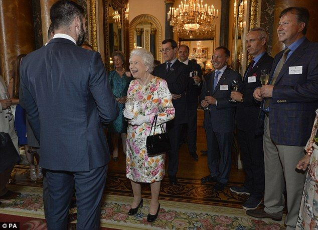 Her Majesty seemed to be in high spirits as she joked with her guests during this evenings reception