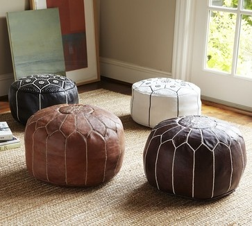 A Moroccan pouf adds that well-worn, traveled feel to a space and provides seating when friends are over. These are sewn by hand by artisans in Marrakesh.
