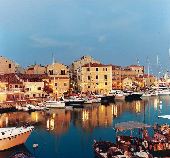 Many Italians swear that Sardinia is tops for beaches, and exploring by boat is ideal. Here, the town of La Maddalena's harbor.