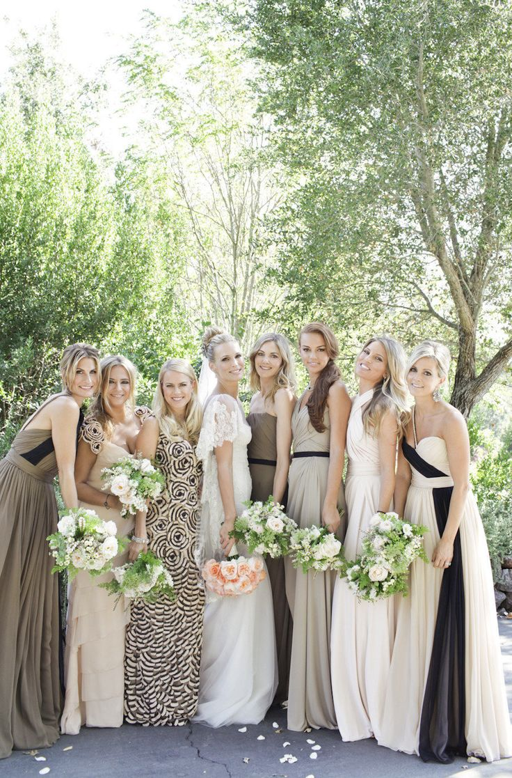 A mix of neutral colored bridesmaid dresses and patterns that come together perfectly
