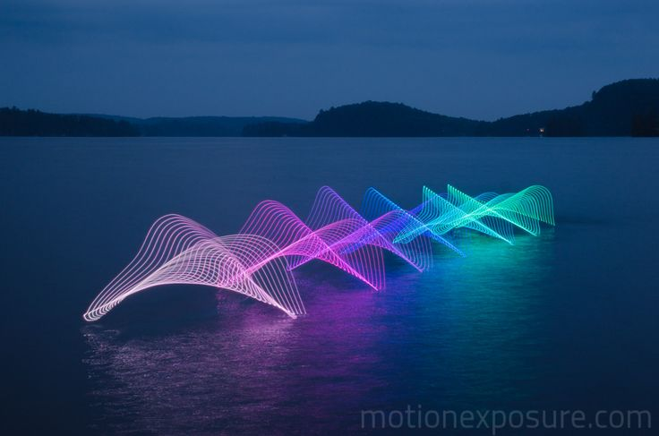 motion of a kayak captured with LED lights and long exposure photography.  by Stephen Orlando