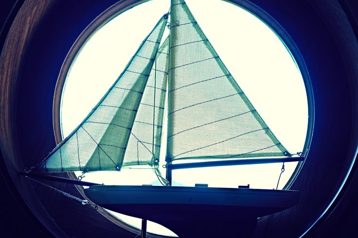 Sailboat Sitting in the Porthole Window  Collection 7  Keep it, use it. This photo is free under creative commons zero.