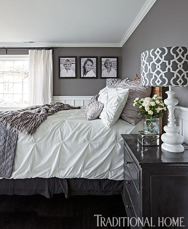 An antique bed is outfitted with coverings from T.J.Maxx, Target, and Z Gallerie in this gray bedroom. - Photo: John Granen / Design: Kristi Spouse