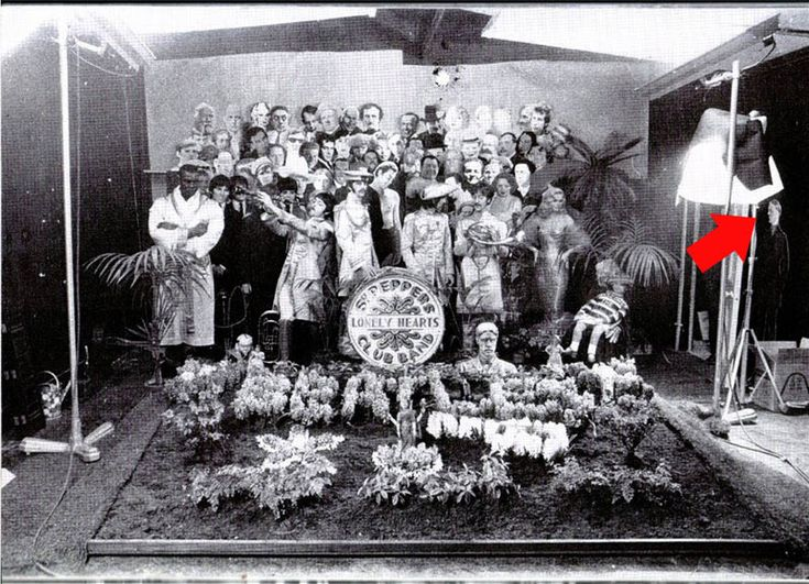 The Beatles Sgt. Pepper's Album cover photo shoot, uncropped. (Arrow points to Hitler who was left out, as was Jesus Christ).