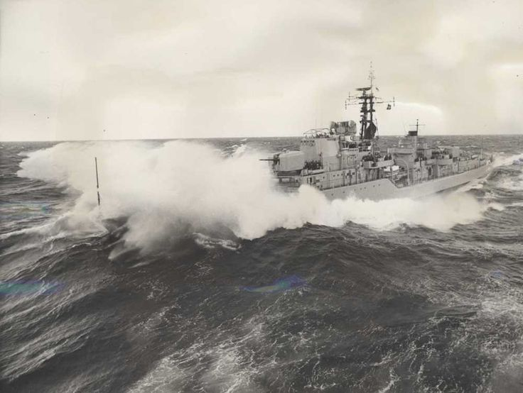 HMAS Vampire in large swell as she approaches HMAS Melbourne, 1966.