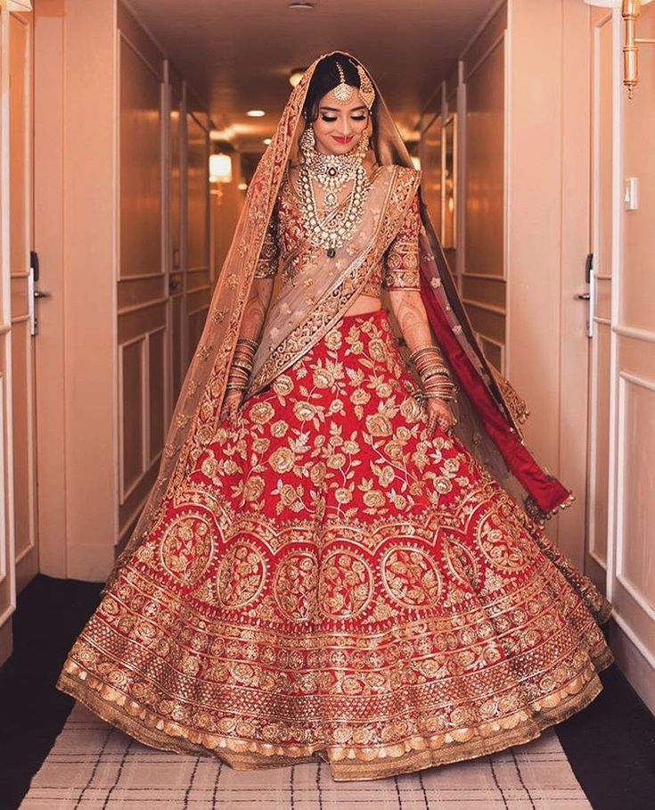 A bride can never go wrong with traditional shades of red and gold, especially when it is a Manish Malhotra ensemble.