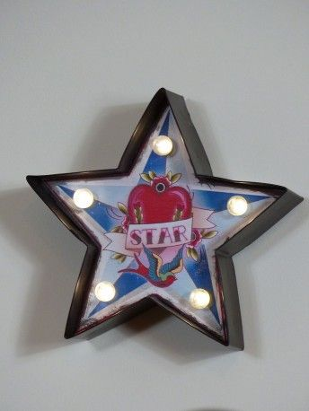 fairground tattoo style star lighting in fun red apple and swallow bird. the ideal gift from her and him in retro design, tattoo effect decor.