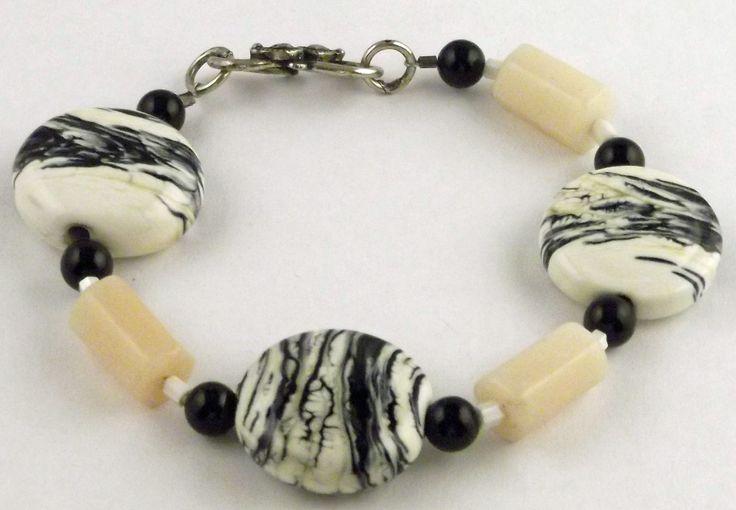 Ivory and black Lampwork glass bead bracelet. Dark Ivory and intense black