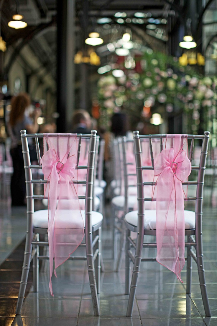 Silver Chiavari chairs with pink organza sashes and rhinestone buckles; Calgary wedding planner and decorator (Photo by Andras Schram Photography)
