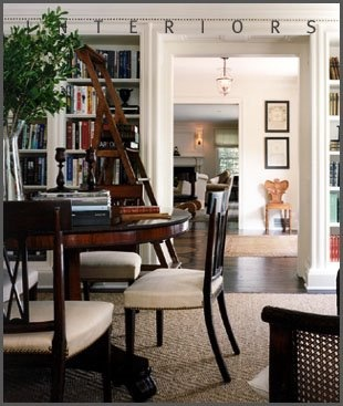 A Bueaitful Dining Room With Built In Bookcases