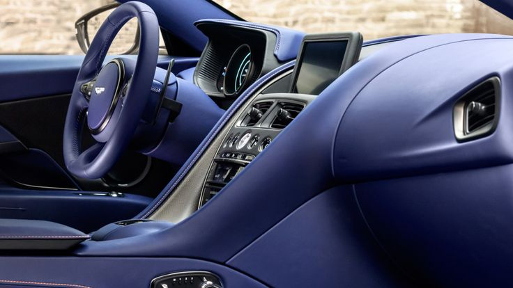 Interior features of the Aston Martin DB11 V8 include Mercedes-Benz's COMAND-based multimedia interface.