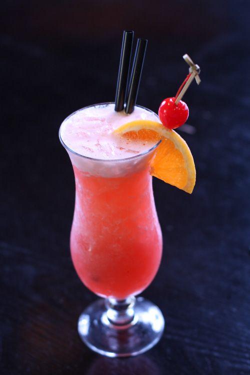 Bahama Mama - ¾ oz Coconut Rum (Malibu), ¾ oz Banana Liqueur (Hiram Walker), 1 oz Spiced Rum (Captain Morgan), 1.5 oz Orange Juice, 2.5 oz Pineapple Juice, 2-4 dashes (1-2 Tbs) Grenadine, ¼ cup crushed ice, Garnish: Orange/Pineapple wedge, 1 Maraschino Cherry (optional)... Combine all the ingredients and mix them in a cocktail shaker. Serve in a cocktail glass. Garnish with Orange/Pineapple wedge